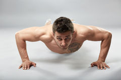 Fitness model doing pushups Stock Photo