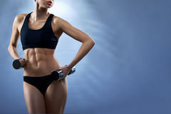 Fitness model with dumbbells Royalty Free Stock Photo