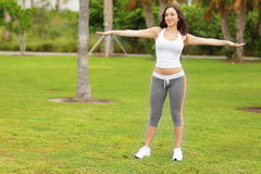 Fitness model exercising in the park Stock Image