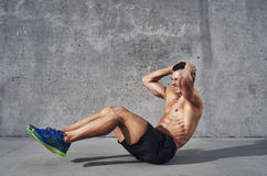 Fitness model exercising sit ups and crunches Stock Photo