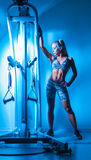Fitness model in the gym Royalty Free Stock Image