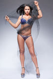 Fitness model with long black hair. Royalty Free Stock Images