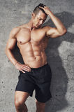 Fitness model portrait, muscular build man relaxing. Royalty Free Stock Photos