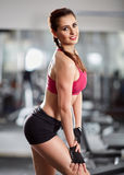 Fitness model posing in gym Stock Photography