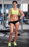 Fitness model posing in gym Stock Photos