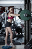 Fitness model posing in the gym Stock Photo