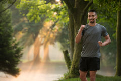 Fitness Model Running Outdoors Trying Weight Loss Stock Photography