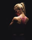 Fitness Model's Back. Portrait of a fitness model showing off her back royalty free stock photos