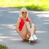 Fitness model on a skateboard Stock Image