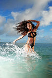 Fitness Model Splashing in Ocean. Fitness model splashing in the ocean in Honduras Stock Photos
