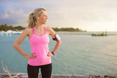 Fitness model standing outdoors in early morning Royalty Free Stock Image