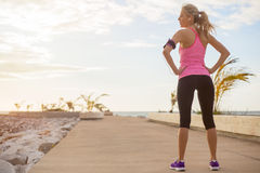 Fitness model standing outdoors in early morning Stock Photography