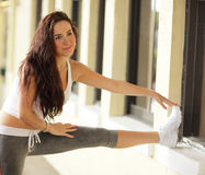 Fitness model stretching Royalty Free Stock Photo