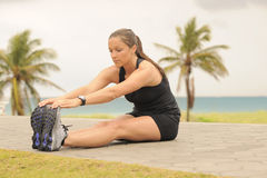 Fitness Model Stretching Leg Royalty Free Stock Photos