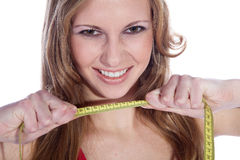 Fitness model with tape measure Stock Image