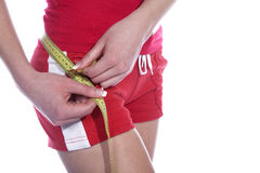Fitness model with tape measure Stock Images