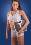 Fitness Model with Weight Scale Stock Images