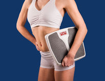 Fitness Model with Weight Scale Stock Photo