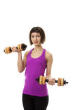 Fitness Model. Weight training with dumbbells but instead of real weight she is using doughnuts as the weights Stock Image