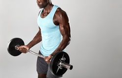 Fitness model working out with weights on grey background Stock Photo