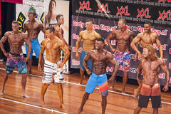 Fitness models showing their chest pose in a lineup comparison Royalty Free Stock Photography