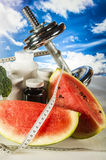 Fitness objects on the blue sky background Stock Image