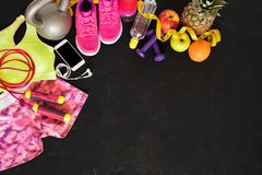 Fitness objects on dark floor Royalty Free Stock Photos