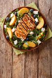 Fitness organic salad from a grilled chicken breast with peaches Royalty Free Stock Image