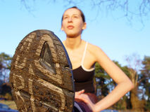 Fitness outdoor. A shot of a young girl doing stretch exercises after jogging Royalty Free Stock Photo