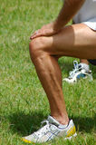 Fitness outdoors. A white male leg and arm of a caucasian man excercising outdoors in nature to improve his fitness Royalty Free Stock Photo