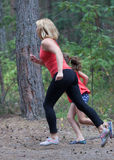 Fitness outdoors mom and daughter Stock Image