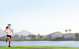 Fitness panorama. Woman running in suburb park for fitness and wellness exercise. healthy lifestyle active panorama with copyspace Stock Photos