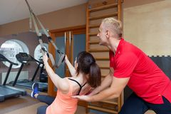 Fitness parners in sportswear doing exercises at gym. Fitness sport gym concept stock photography