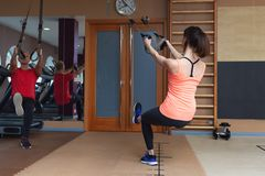 Fitness parners in sportswear doing exercises at gym. Fitness sport gym concept stock images