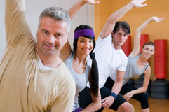 Fitness people doing aerobic exercises stock image