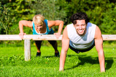 Fitness people doing pushups for sport stock images