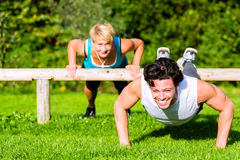 Fitness people doing pushups for sport Stock Image