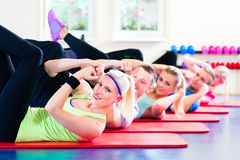 Fitness people in gym doing crunches Royalty Free Stock Photo