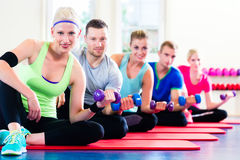 Fitness people in gym working out - dumbbells Royalty Free Stock Photo