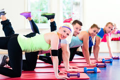 Fitness people in gym working out with dumbbells Royalty Free Stock Photography