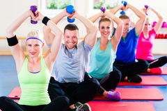 Fitness people in gym working out with dumbbells Royalty Free Stock Image