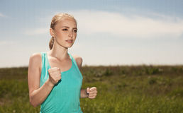 Fitness people and healthy lifestyle concept young female runner Royalty Free Stock Images