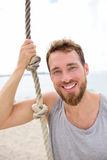 Fitness people portrait - healthy man with rope Royalty Free Stock Image