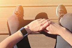 Fitness people using smart watch. Women runner getting ready for Royalty Free Stock Images