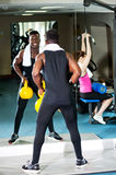 Fitness people working out with equipments Royalty Free Stock Photography