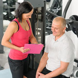 Fitness personal plan active man with trainer. Fitness center personal plan happy active men with trainer Royalty Free Stock Photo
