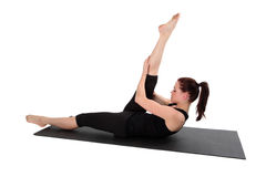 Fitness - Pilates. Beautiful young lady doing exercise.  Pilates and aerobics Royalty Free Stock Image