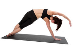 Fitness - Pilates. Beautiful young lady doing exercise.  Pilates and aerobics Stock Photos