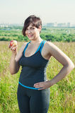 Fitness plus size woman with apple Stock Image