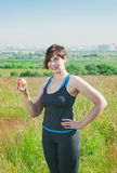 Fitness plus size woman with apple Royalty Free Stock Photo